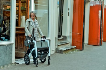 Lady walking in Amsterdam with rollator