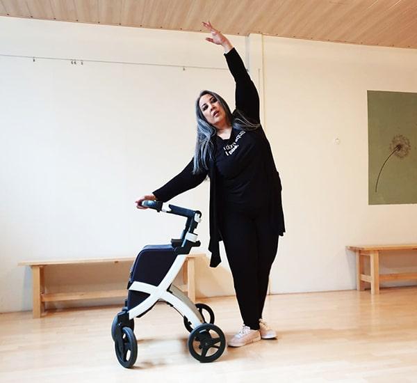Woman dancing with a Rollz Flex lightweight rollator