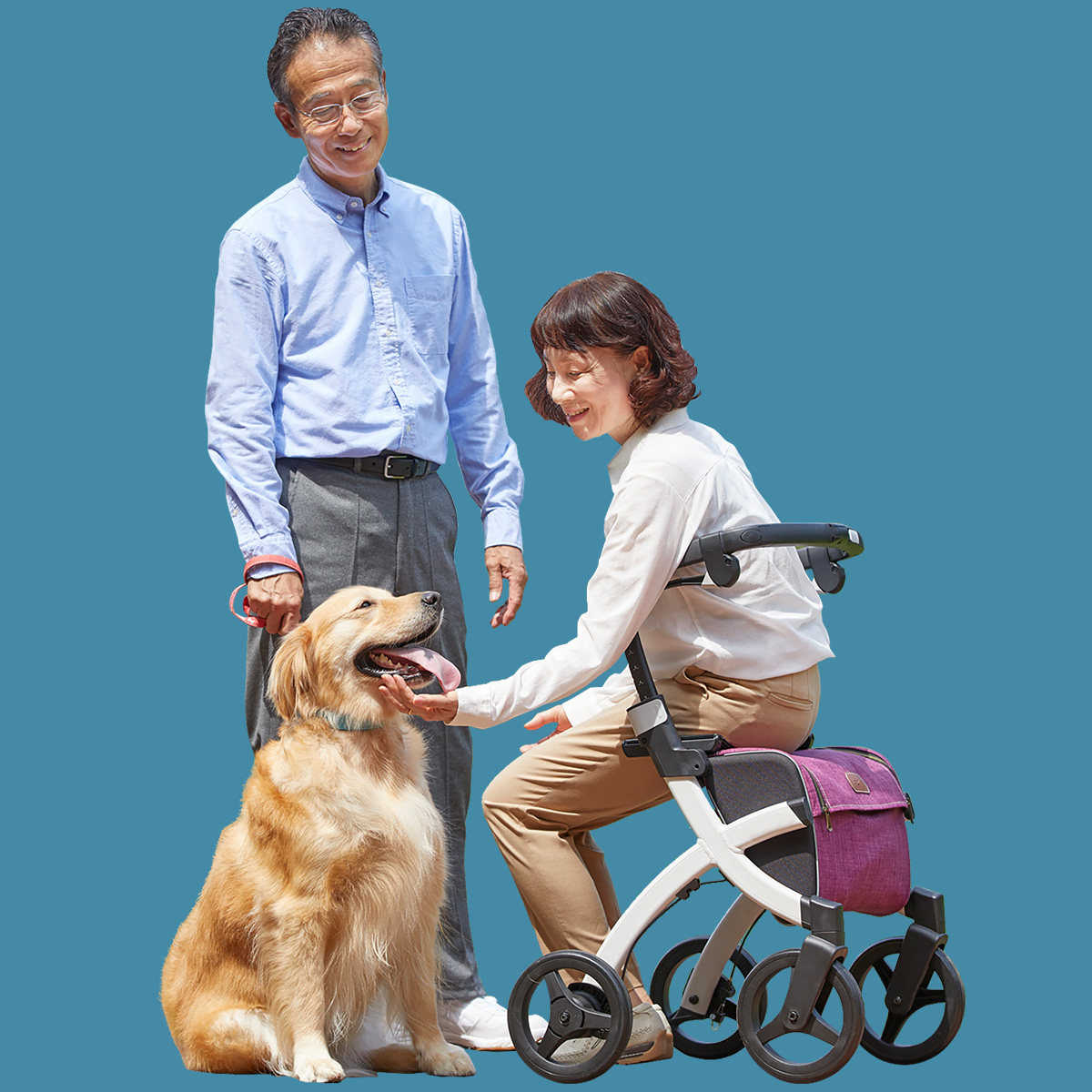 A woman sitting on a Rollz Flex rollator and petting her dog